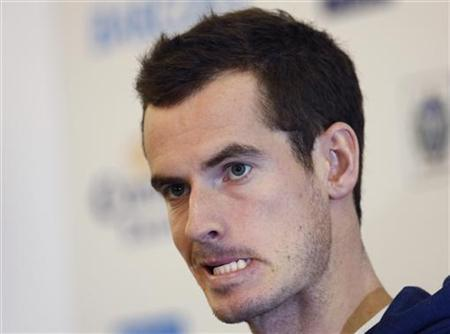 Britain's Andy Murray clenches his jaw while speaking with the media ahead of the ATP World Tour finals tennis tournament at the O2 stadium in London November 3, 2012. REUTERS/Chris Helgren