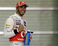 McLaren Formula One driver Lewis Hamilton of Britain celebrates after taking pole position in the qualifying session of the Abu Dhabi F1 Grand Prix at the Yas Marina circuit on Yas Island November 3, 2012. REUTERS/Suhaib Salem