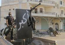 A Free Syrian Army fighter stands guard during clashes with President Bashar al-Assad's forces in the Taftanaz area near Idlib November 3, 2012. REUTERS/Abdalghne Karoof