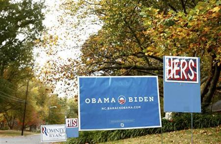 Two separate campaign signs for U.S. presidential candidates Barack Obama and Mitt Romney are seen outside of a home in Charlotte, North Carolina October 27, 2012. REUTERS/Chris Keane