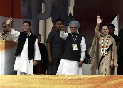 India's Prime Minister Manmohan Singh (C), Chief of India's ruling Congress party Sonia Gandhi (R) and Rahul Gandhi, a lawmaker and son of Sonia, wave to their supporters during rally in New Delhi's Ramlila Maidan ground November 4, 2012. India's embattled Congress party, led by Sonia Gandhi, sought to drum up support for the contentious opening up of the country's vast retail sector to big foreign chains at a mass rally on Sunday, saying supermarkets would help farmers and consumers battling high inflation. REUTERS/Mansi Thapliyal