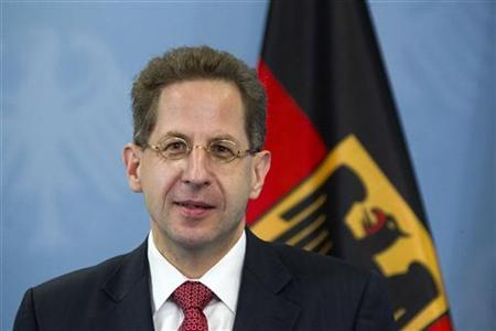 The new president of Germany's intelligence agency, the Verfassungsschutz, Hans-Georg Maassen, poses for pictures before being handed the letter of appointment in Berlin, August 1, 2012. REUTERS/Thomas Peter
