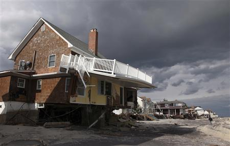 A home damaged by Hurricane Sandy is seen between the ocean and Rt 35 in Bayhead, New Jersey, November 2, 2012 in this handout image courtesy of the governor's office. Picture taken November 2, 2012. REUTERS/New Jersey Governor's Office/Tim Larsen/Handout