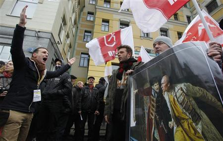 Participants hold a cartoon depicting Russia's President Vladimir Putin (R) and Chechen leader Ramzan Kadyrov as they attend a ''Russian March'' demonstration on National Unity Day in Moscow November 4, 2012. Russia marks the National Unity Day on November 4 when it celebrates the defeat of Polish invaders in 1612. REUTERS/Maxim Shemetov