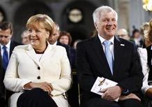 German Chancellor Angela Merkel (L), Bavarian Prime Minister and leader of the Christian Social Union (CSU) Horst Seehofer attend an oecumenic service at St. Michaels church during the 22nd German Unification Day festivities in Munich October 3, 2012. REUTERS/Michaela Rehle