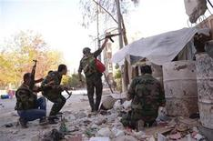 Forces loyal to Syria's President Bashar al-Assad are seen at Maysaloun area, in Aleppo city November 3, 2012, after clashes with Free Syrian Army fighters. REUTERS/George Ourfalian
