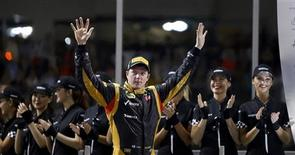 Lotus F1 Formula One driver Kimi Raikkonen of Finland celebrates after winning the Abu Dhabi F1 Grand Prix at the Yas Marina circuit on Yas Island November 4, 2012. REUTERS/Suhaib Salem