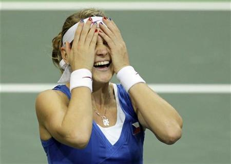 Czech Republic's Lucie Safarova reacts after defeating Serbia's Jelena Jankovic during their final match of the Fed Cup tennis tournament in Prague November 4, 2012. REUTERS/David W Cerny