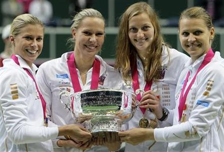 Czech Republic's team members (L-R) Andrea Hlavackova, Lucie Hradecka, Petra Kvitova and Lucie Safarova celebrate with the trophy after winning their final match of the Fed Cup tennis tournament against Serbia in Prague November 4, 2012. REUTERS/David W Cerny