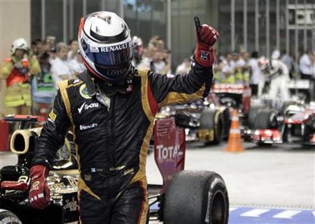 Lotus F1 Formula One driver Kimi Raikkonen of Finland celebrates after winning the Abu Dhabi F1 Grand Prix at the Yas Marina circuit on Yas Island November 4, 2012. REUTERS/Ahmed Jadallah