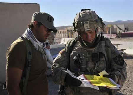 Staff Sgt. Robert Bales, (R) 1st platoon sergeant, Blackhorse Company, 2nd Battalion, 3rd Infantry Regiment, 3rd Stryker Brigade Combat Team, 2nd Infantry Division, is seen during an exercise at the National Training Center in Fort Irwin, California, in this August 23, 2011 DVIDS handout photo. REUTERS/Department of Defense/Spc. Ryan Hallock/Handout/Files