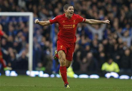 Liverpool's Steven Gerrard celebrates after Luis Suarez scored a goal only for it to be disallowed during their English Premier League soccer match against Everton at Goodison Park in Liverpool, northern England, October 28, 2012. REUTERS/Phil Noble
