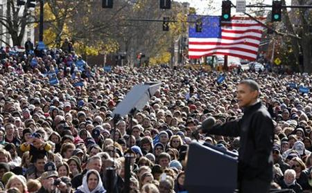 U.S. President Barack Obama is watched by a crowd at a campaign event at State Capitol Square in Concord, New Hampshire, November 4, 2012. REUTERS/Larry Downing