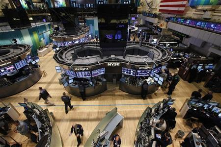 Traders work on the floor of the New York Stock Exchange following its reopening October 31, 2012. REUTERS/Brendan McDermid