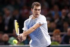 Jerzy Janowicz of Poland returns the ball during his final men's singles match against David Ferrer of Spain at the Paris Masters tennis tournament November 4, 2012. REUTERS/Cedric Lecocq