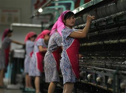 Women work in the Kim Jong-suk Pyongyang Silk Mill in Pyongyang in this April 9, 2012 file photo. The factory is named after the wife of North Korea founder Kim Il-sung. REUTERS/Bobby Yip/Files