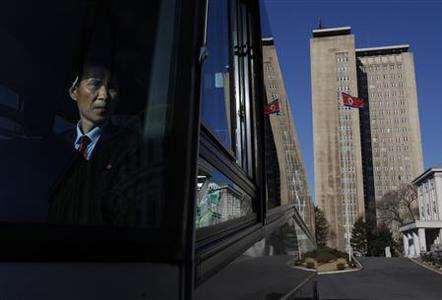 A bus driver prepares to start a media tour through Pyongyang in this April 11, 2012 file photo. REUTERS/Bobby Yip/Files