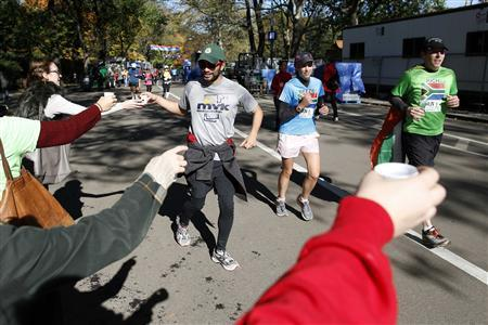 Disappointed NYC marathoners run in aid of Sandy victims