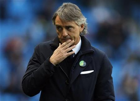 Manchester City's manager Roberto Mancini walks to his seat before their English Premier League soccer match against Swansea City at The Etihad Stadium in Manchester, northern England, October 27, 2012. REUTERS/Phil Noble
