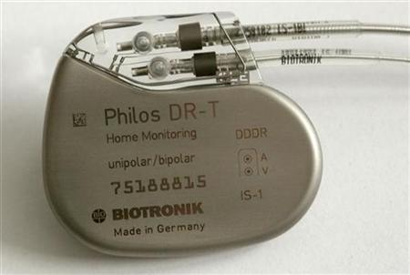A German pacemaker is shown against the backdrop of a cardiological graph at the St. Josefs hospital in the eastern city of Potsdam in this February 26, 2004 file photo. REUTERS/Arnd Wiegmann/Files