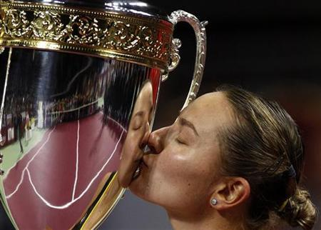Nadia Petrova of Russia kisses the trophy after defeating Caroline Wozniacki of Denmark at their WTA Tournament of Champions final match in Sofia November 4, 2012. REUTERS/Stoyan Nenov