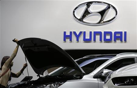 A visitor looks at a car at the Hyundai showcase on media day at the Paris Mondial de l'Automobile in this September 28, 2012 file photo. REUTERS/Christian Hartmann/Files
