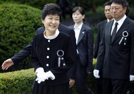 Park Geun-hye walks after a memorial service for her mother and the late first lady Yuk Young-soo at the national cemetery in Seoul in this picture taken August 15, 2012. REUTERS/Lee Jae-Won/Files