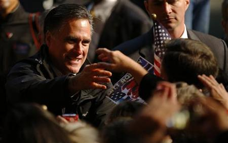 Republican presidential nominee Mitt Romney greets audience members at a campaign rally in Newport News, Virginia November 4, 2012. REUTERS/Brian Snyder