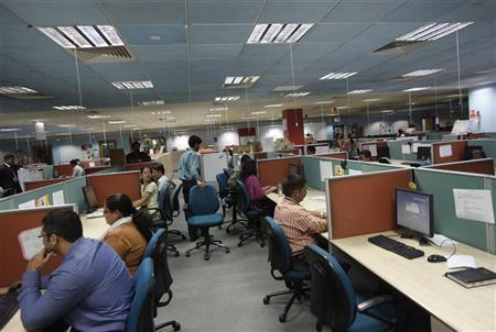 Employees work on the floor of the outsourcing company WNS in Mumbai March 19, 2012. REUTERS/Vivek Prakash/Files