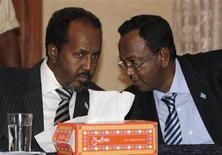 President of Somalia Hassan Sheikh Mohamud (L) and Prime Minister Abdi Farah Shirdon Saaid confer during the appointment of Somalia's cabinet at the presidential palace in Mogadishu November 4, 2012. REUTERS/Omar Faruk