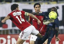 "Hossam Ghaly of Egypt's Al Ahli (L) fights for the ball with Yannick N'Djeng of Tunisia's Esperance Sportive during their African Champions League (CAF) final soccer match at Borg El Arab ""Army Stadium"" west of the Mediterranean city of Alexandria, 230 km (143 miles) north of Cairo, November 4, 2012. REUTERS/Stringer"