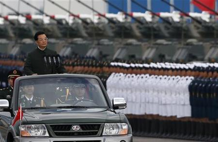 Chinese President Hu Jintao inspects a military parade during his visit to an airbase in Hong Kong June 29, 2012. REUTERS/Bobby Yip