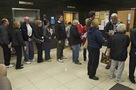 Voters line up to vote after completing a vote by mail form at the Ocean County Administration form as residents continue to clean up after Hurricane Sandy in Toms River, New Jersey, November 4, 2012. REUTERS/Steve Nesius