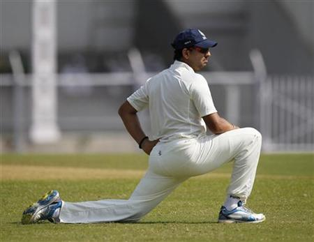 India A cricket team's Yuvraj Singh stretches on the second day of the warm-up game against England in Mumbai October 31, 2012. REUTERS/Danish Siddiqui