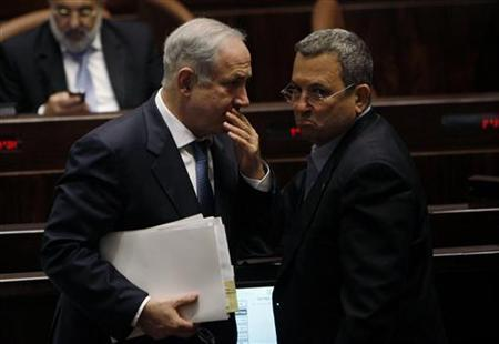 Israel's Prime Minister Benjamin Netanyahu (L) speaks with Defence Minister Ehud Barak after a non-confidence vote at the Knesset, the Israeli parliament, in Jerusalem June 8, 2009. REUTERS/Ronen Zvulun