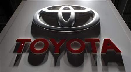 A logo is seen on the Toyota booth on media day at the Paris Mondial de l'Automobile, in this file picture taken September 27, 2012. REUTERS/Christian Hartmann/Files