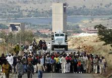 Striking miners chant slogans as they gather at the AngloGold Ashanti mine in Carletonville, northwest of Johannesburg October 25, 2012. REUTERS/Siphiwe Sibeko