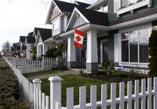 Canadian flags are seen on houses in the Vancouver suburb of Richmond prior to the Vancouver 2010 Winter Olympic Games February 9, 2010. REUTERS/Chris Helgren