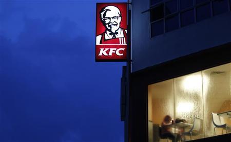 A customer eats at a KFC fast food restaurant in Dengkil, outside Kuala Lumpur November 3, 2012. REUTERS/Bazuki Muhammad