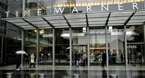 People walk in front of the Time Warner Inc. headquarters building at Columbus Circle in New York October 13, 2005.