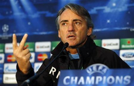 Manchester City's manager Roberto Mancini gestures during a news conference at the club's Carrington training complex in Manchester, northern England, November 5, 2012. REUTERS/Phil Noble