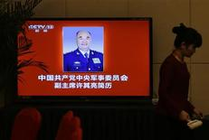 A screen shows a portrait of Xu Qiliang, new vice-chairmen of the Central Military Commission (CMC) of the Communist Party of China (CPC) at a media center for the upcoming 18th National Congress of the CPC, in Beijing November 5, 2012. REUTERS/Jason Lee