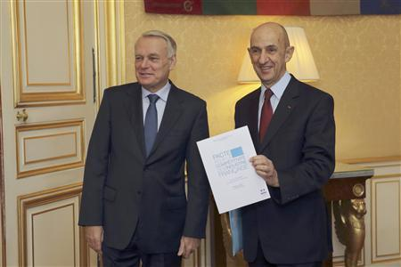 French industrialist Louis Gallois (R) hands over his report on competitiveness to France's Prime Minister Jean-Marc Ayrault at his Hotel Matignon offices in Paris November 5, 2012. REUTERS/Philippe Wojazer