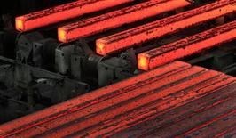 Formed steel bars are pictured inside the steel mill of German steel maker Lech-Stahlwerke GmbH in Meitingen near Augsburg October 9, 2012. REUTERS/Michaela Rehle