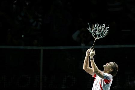 David Ferrer of Spain celebrates with trophy after winning his final men's singles match against Jerzy Janowicz of Poland at the Paris Masters tennis tournament November 4, 2012. REUTERS/Benoit Tessier