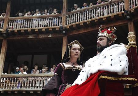 Actors Dominic Rowan (R) and Kate Duchene perform as Henry VIII and Queen Katherine in Shakespeare's Henry VIII at the Globe theatre in London July 6, 2010. REUTERS/Luke MacGregor/Files