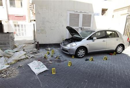 Crime scene markers are seen at a bomb site in capital of Manama, Bahrain, November 5, 2012. REUTERS/Hamad I Mohammed