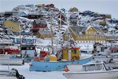 Fishing boats sit in the harbour in the town of Uummannaq in western Greenland March 18, 2010. REUTERS/Svebor Kranjc