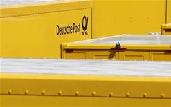 The sign of German postal and logistics group Deutsche Post DHL is pictured on a lorry at a branch office in Fuerstenfeldbruck near Munich June 18, 2012. REUTERS/Michaela Rehle