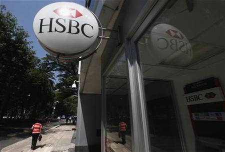 A person walks past a HSBC branch office in Mexico City July 27, 2012. The money-laundering scandal that hit HSBC Holdings Plc in Mexico was an isolated case in Latin America's second-biggest economy, the head of the country's banks association (ABM) was quoted as saying on Friday. Mexico's National Banking and Securities Commission (CNBV) levied a $27.5 million fine against the British bank after a scathing U.S. Senate report last week slammed HSBC for letting clients shift funds from dangerous and secretive countries. REUTERS/Edgard Garrido (MEXICO - Tags: BUSINESS CRIME LAW)